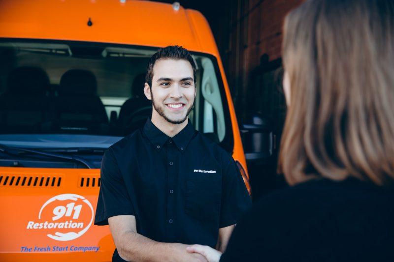 fire damage restoration technician speaking with customer
