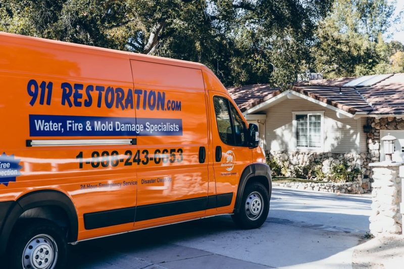 disaster restoration vehicle in front of home